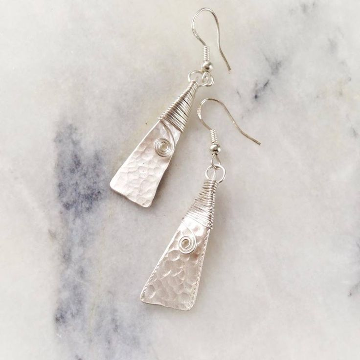 Tiki Kiwi Designs hammered silver toki earrings meaning strength and courage NZ$197