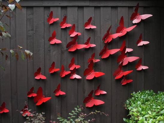 Butterflies created by Curtis Fesser adorn a fence in the front yard of his home. Lush, leafy East Dallas property inspires with art, water-conserving features | Dallas Morning News
