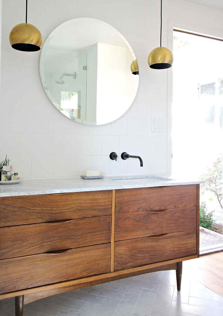 A blah bathroom gets a marvelously modern makeover - Round mirror over bathroom vanity ...