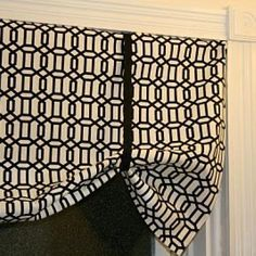 Easy no sew valance.  A very long window valance would need to be pulled up in at least four different places.
