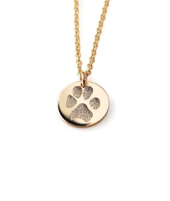 Keep your beloved pets paw print close to your heart... A name can be engraved on the back of the pendant at no additional cost. Font options pictured in third image.  • Material: 14k yellow gold filled or solid sterling silver ~ not plated • Disc diameter: 1/2 (13mm) (petite) • puffed heart charm included • Gift boxed • Various chain lengths are available in a drop-down box during checkout  PAWS: I can work with a photo of the paw showing the pads of the paw, a paw ink imprint or an ima...
