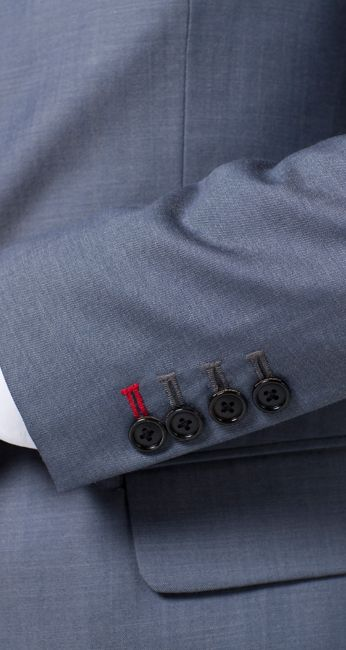 Indochino introduces contrasting button-hole accents. Very cool!
