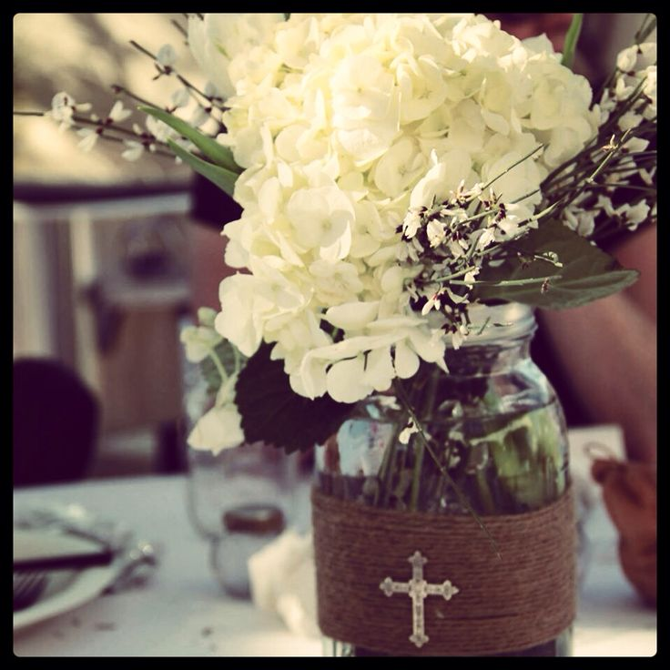 Centerpieces for a baptism celebration! All you need are mason jars, twine, a hot glue gun, and crosses!