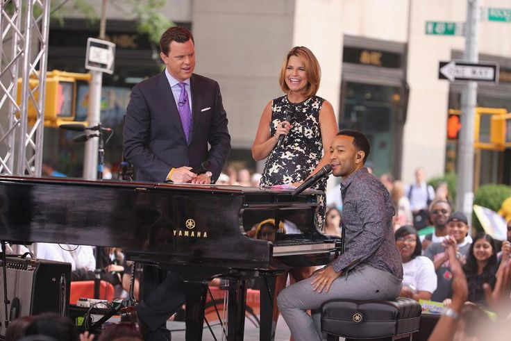 John Legend performs on The Today Show and shares a laugh with Willie Geist and Savannah Guthrie in New York City on July 10, 2014.