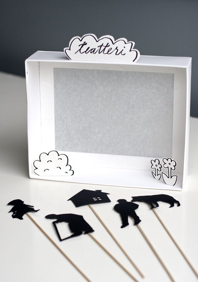 DIY shadow puppet theatre -  love the monochrome pallet and simplicity