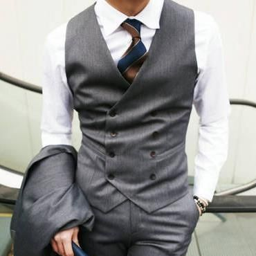 A double-breasted waistcoat. Generally, I don't like double-breasted waistcoats without a lapel, but I think that this one works.