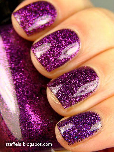 I really do have an addiction to purple nail polish......love