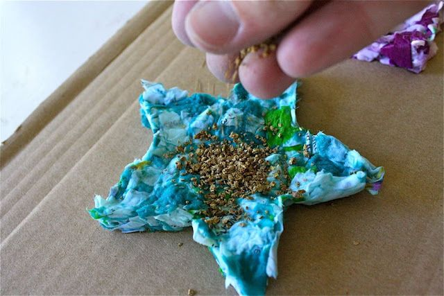 seed starter-half shredded copy paper/half shredded tissue paper(for color) add water and mix to make kinda like a paste- press in cookie cutter to shape, then press over screen or strainer to remove excess water-sprinkle wild flower seeds on top and allow to dry a few days.