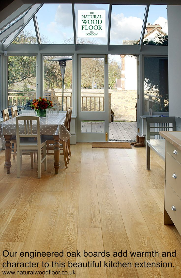 Our engineered oak boards add character and warmth to this stylish kitchen extension. www.naturalwoodfloor.co.uk