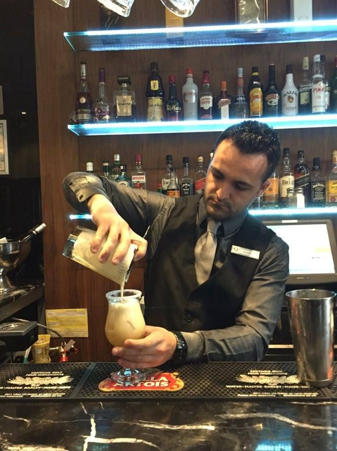 Our talented bartender Claudio preparing and serving up another yummy cocktail at the Q Bar of The Queens Gate Hotel! #London #LondonLife #LuxuryTravel #Travel #Europe #Kensington #Bar #Restaurant #Hotel http://www.thequeensgatehotel.com/bar_restaurant_london_hotel/