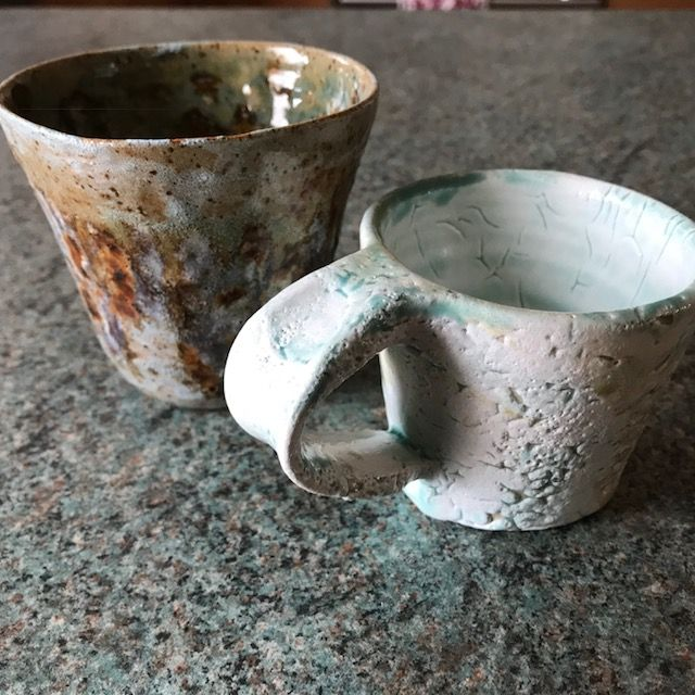 Left handed mug - white tin which crawled and celadon