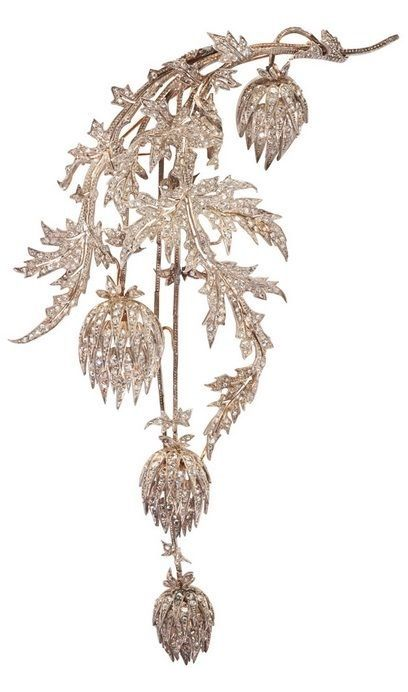 A large Lorraine thistle jewel rendered in silver-topped gold, frosted with rose cut diamonds, marked Andre Kauffer. Ft (farbricane) Joaillier-Orfevre, Nancy. French marks for 18k and silver. Maker marks of François Fleuret and A. Kauffer, Nancy, ca. 1890