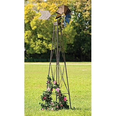 """Windmill Obelisk, Item #47633. $99.99    Add a touch of country flair from days gone by to your lawn or garden with our impressive 72"""" tall windmill obelisk. Provides ample room for your climbing plants to grow upward for dramatic vertical effect. The wind powered fan at the top of the tower spins around and turns back and forth in the gentlest of breezes. Made of weather resistant powder coated steel. Fan measure 15"""" in diameter with a 22"""" long tail."""