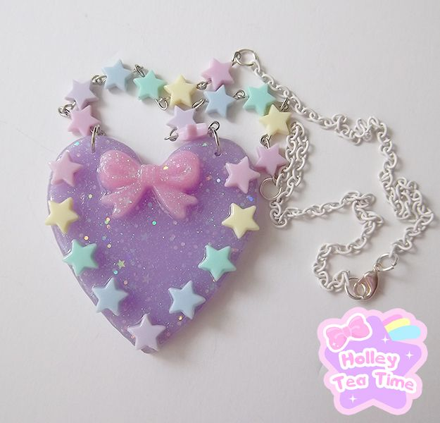"☆ made from resin, paint, glitter and star beads  ☆ heart charm is semi transparent purple / lavender color  ☆ the star beads are made of plastic  ☆ chain is a white and made of enamel  ☆ heart charm size: 6.5 cm x 6.5 cm (2.5""x2.5"")  ☆ chain length: 52 cm (20.4"")  ☆ handmade"