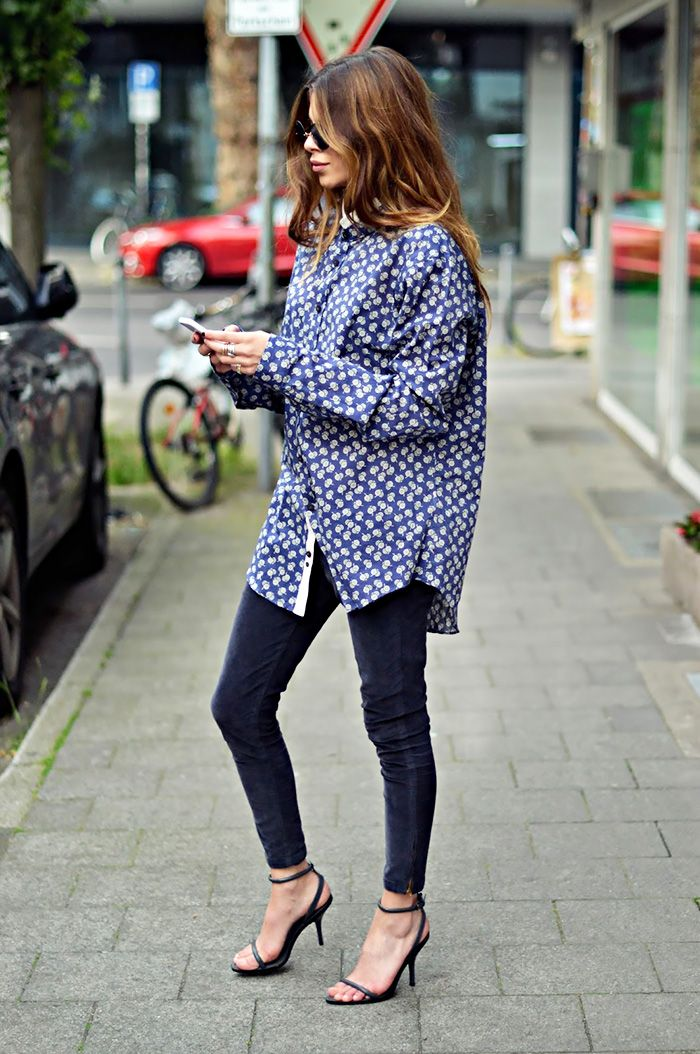 Maja Wyh wearing dark skinny jeans, oversized printed button-down, and black ankle strap heels