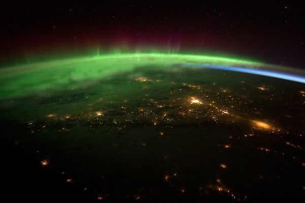 Electric Blanket    Photograph from NASA via AFP/Getty Images    The soft green glow of the aurora borealis seems to swaddle the Pacific Northwest in a recently released picture taken by astronauts aboard the International Space Station.    Familiar green auroras appear lower in the atmosphere, around 60 miles (100 kilometers) above the surface. At altitudes round 185 to 310 miles (300 to 500 kilometers), the light displays are pure red. (See more aurora pictures.)