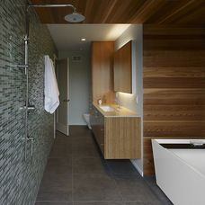 Glass tiles and concrete floors contrast wood nicely