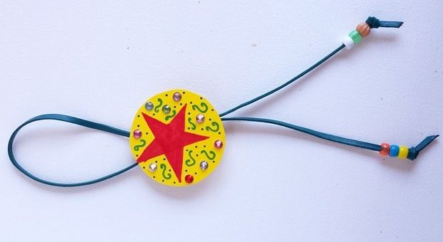 Make a quick, easy, personalized bolo tie for the Calgary Stampede! A bolo tie is perfect as part of a cowgirl or cowboy costume and great for everyday dress up.