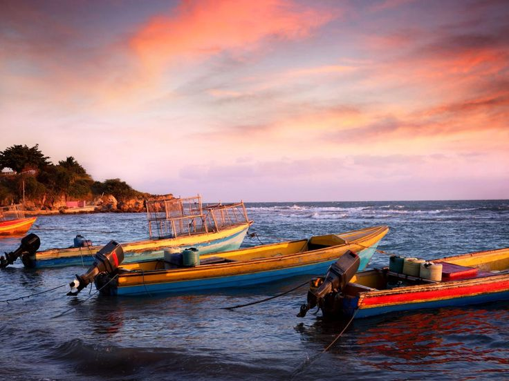 Fishing boats cast off on Jamaica's famous Treasure Beach. The beach stretches 6 miles along the island's southern coast.