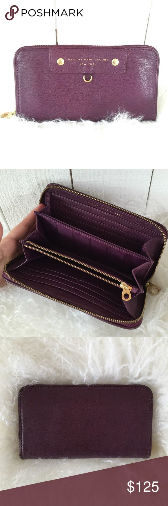 "Marc Jacobs Wallet Large eggplant colored leather Marc Jacobs wallet. Like new condition. Very minimal, normal wear to the goldtone hardware. This is 9""x4.5"" and I have used it as a small clutch. Lots of card storage! Marc by Marc Jacobs Bags Wallets"