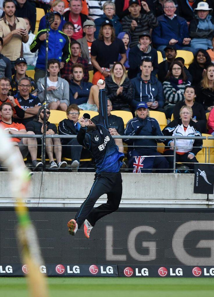 Dan Vettori goes for a high catch.