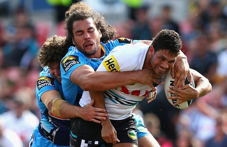 Brad Tighe of the Panthers is tackled by Ryan James of the Titans is tackled during the round four NRL match between the Penrith Panthers and the Gold Coast Titans at Centrebet Stadium on March 31, 2013 in Penrith, Australia. (Photo by Ryan Pierse/Getty Images)