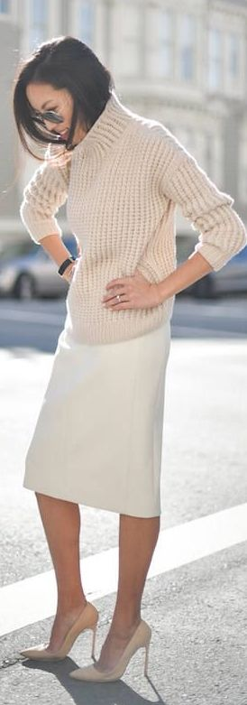 Modest minimalist outfit with beige sweater and white midi pencil skirt                                                                                                                                                     More
