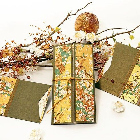 Wedding invitation of Japanese inspiration. Golden green embellished by almond blossoms