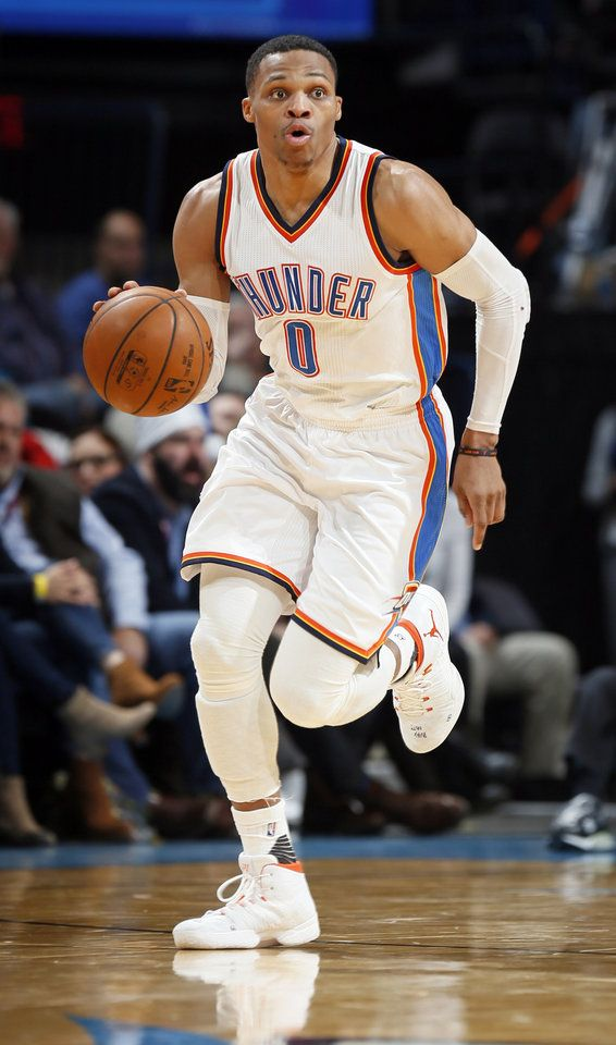 Oklahoma City's Russell Westbrook (0) dribbles the ball during an NBA basketball game between the Oklahoma City Thunder and the Phoenix Suns at Chesapeake Energy Arena in Norman, Okla., Saturday, Dec. 17, 2016. Oklahoma City won 114-101. Photo by Nate Billings, The Oklahoman