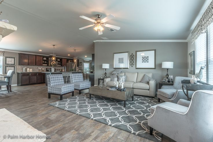This efficient open living area in Palm Harbor's La Sierra manufactured home is perfect for daily living or entertaining - 3 Bedrooms, 2 Baths, 2077 Sq. Ft