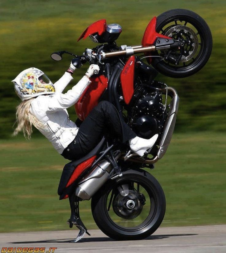 Jessica Maine decked out in Icon gear on a red Triumph.