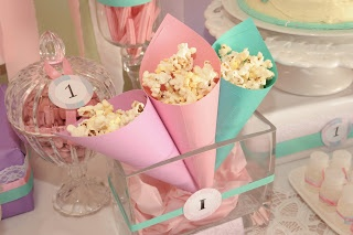 treat cone; have enough empty cones near a dessert bar and let your guest help themselves. great for all those small treats