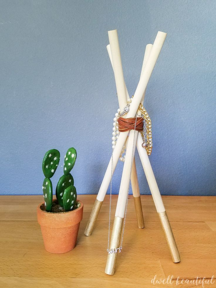 Learn how to make an easy DIY wooden dowel teepee jewelry holder. The perfect modern bohemian Scandinavian jewelry stand! #monthlydiychallenge