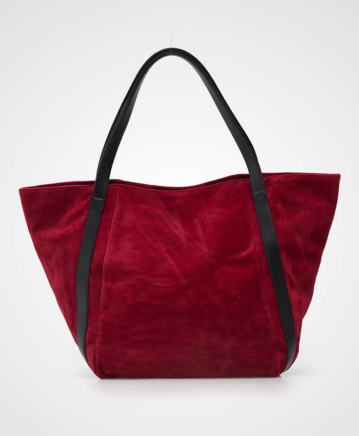 Red Beautiful Suede Bag by Primrose. A pretty tote bag that made from suede material and contrasted listed handle, this red tote bag sure look so gorgeous. Pair it with your semi casual afternoon outfit. http://www.zocko.com/z/JJBbK