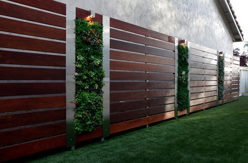 Have plants grow across the top & down instead of up.  Add driplines inside so we don't have to water. The wood horizontal could contrast with the color of the vertical fence behind it. WW privacy wall with planters