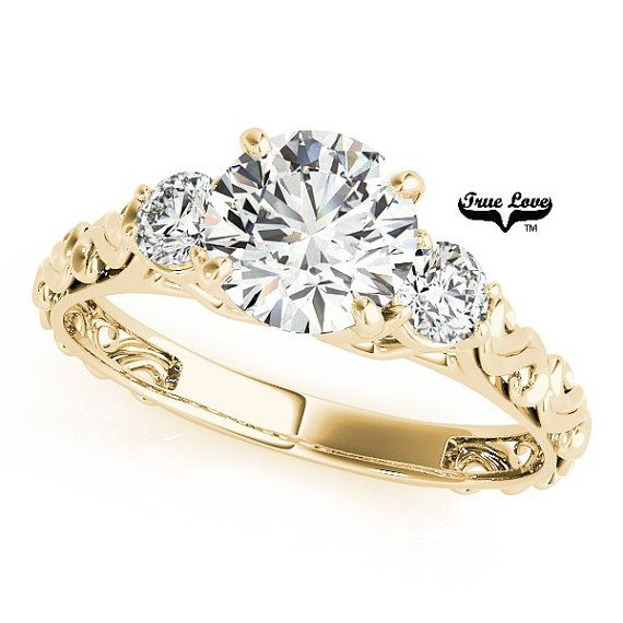 Moissanite Engagement Ring14 kt. Yellow Gold by TrekJewellers