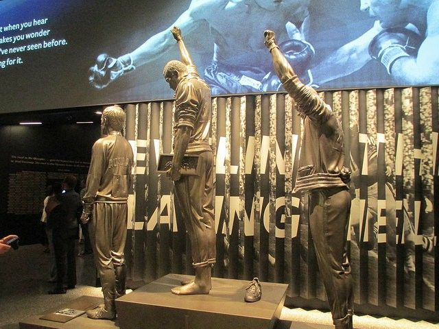 Tommie Smith and John Carlos (with Australia's Peter Norman) statue at the Smithsonian African-American History Museum
