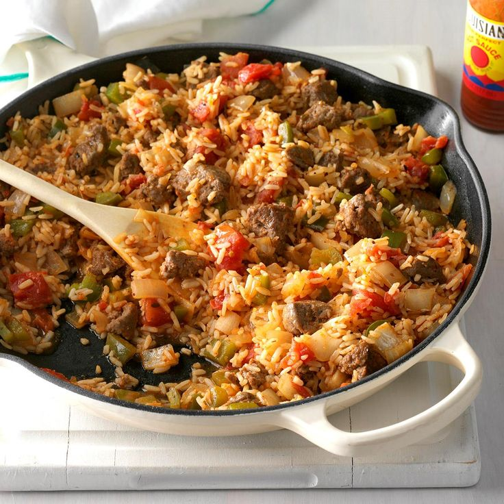 Spicy Cajun Sausage and Rice Skillet Recipe -I created this easy skillet dish to use up the boil-in-a-bag rice in my cabinet. The result packs a lot of flavor. —Sonali Ruder, New York, New York