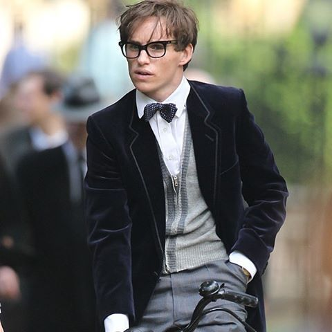 For #WaistcoatWednesday, #EddieRedmayne as #StephenHawking in velvet, bow tie and specs atop a bike at @cambridgeuniversity for #TheTheoryofEverything.