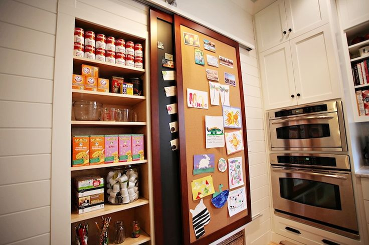 White Shiplap Paneling Flanking Concealed Pantry Hidden