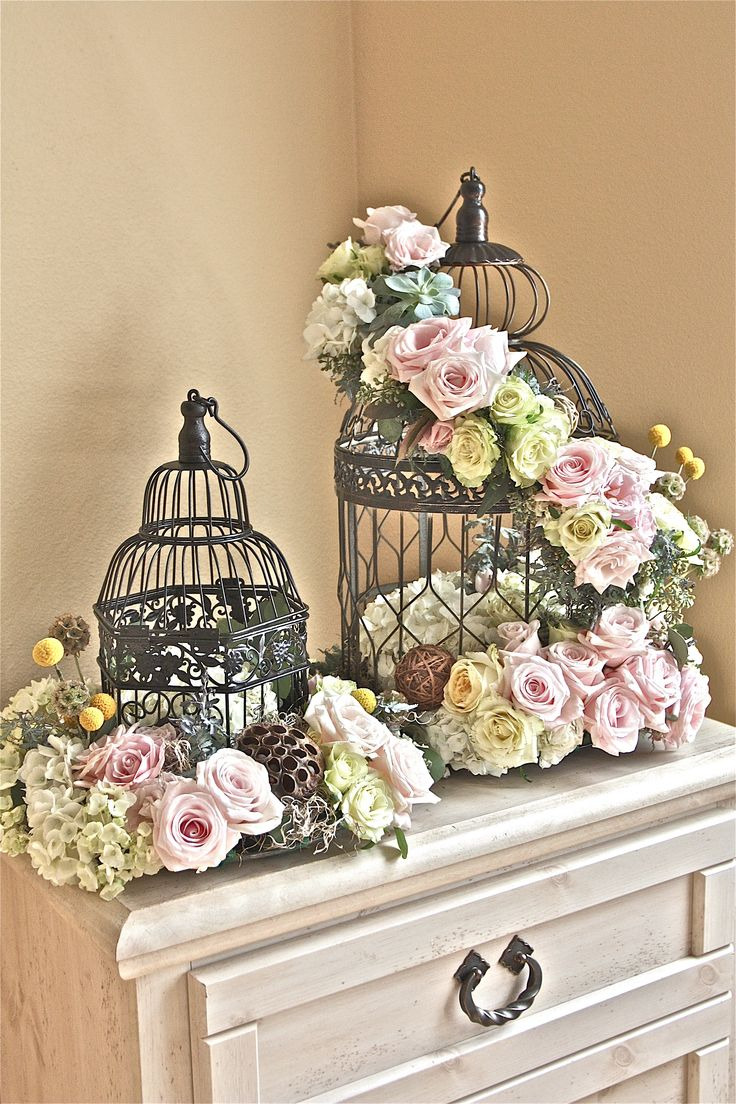 stunning - use silver birdcage, add in candles in the center and small votives around  - could use as a centerpiece