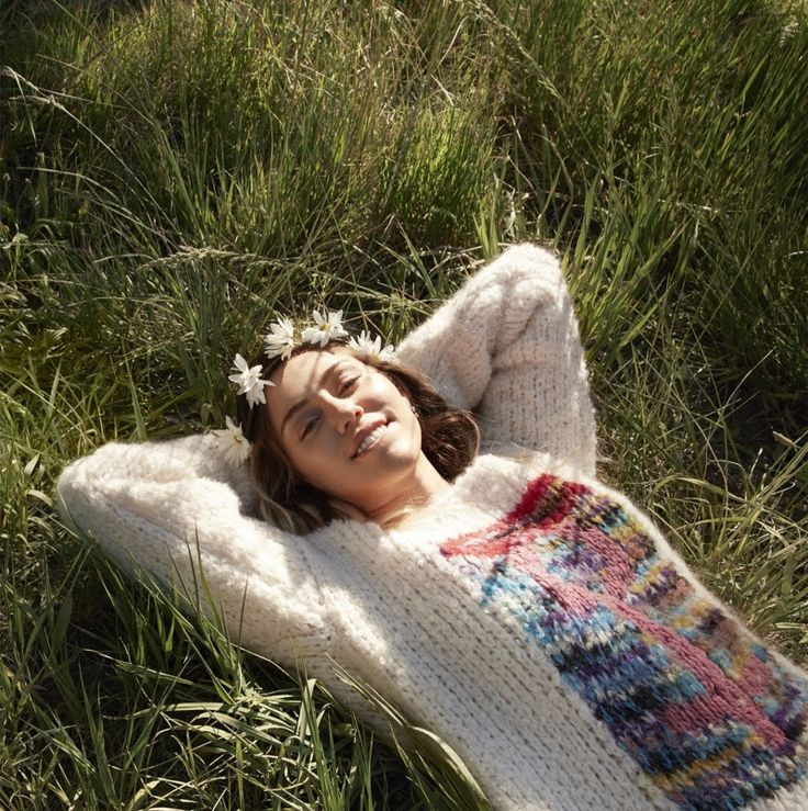 Wearing a flower crown, Miley Cyrus models Missoni sweater