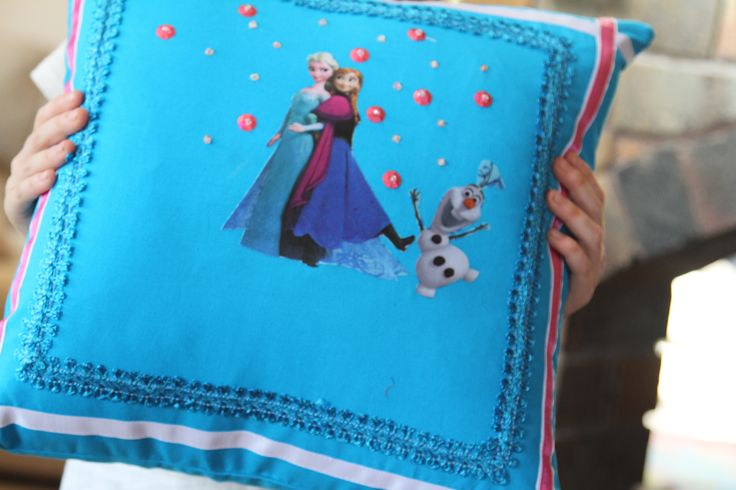 Student showing of her cushion Design Project  from the Junior Learn2sew Workshops