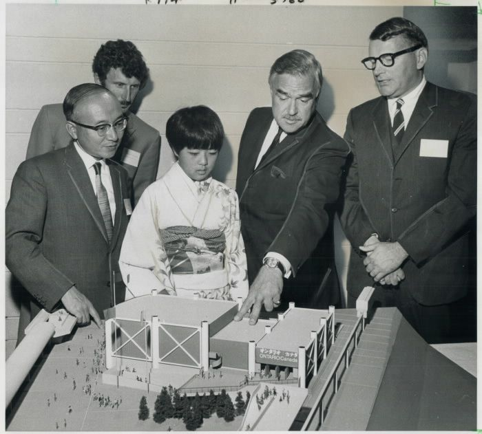 Watched by kimona-clad Japanese girl Ontrio Premier John Robarts last night points out to Japanese Consul Ryoko Ishikwa (left) features of Ontario Pavilion the province plans to erect for Expo 70 in Osaka; Japan. With them are Chris Chapman and Douglas Rowland (right); the architect who designed building.