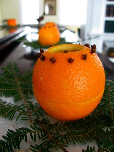 Make a candle holder out of an orange peel tutorial. As the votive heats the orange peel and cloves, their fragrance will fill the room