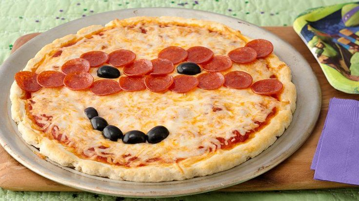Kids will have fun making this masked pizza for the party!