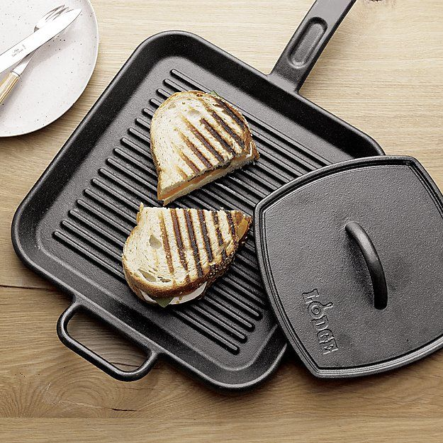 """Shop Lodge Cast Iron Panini Press. Crafted of classic cast iron with convenient handle, this ridged press perfectly """"grills"""" panini, sandwiches, burgers and chicken breasts indoors."""