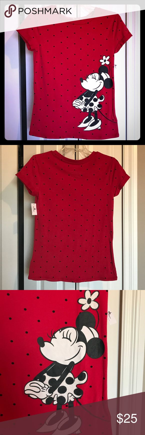 Minnie Mouse Dots Shirt Brand new with tags!! Purchased at Disney Springs!! Women's XS t-shirt in the ever popular Minnie Dots Was $35 with tax. Sleeves are rolled, Minnie is a vinyl print with sparkly white glitter on her skirt and flower. Softest fabric, and stretchy! No rips, stains, or tears.  No trades. Disney Tops Tees - Short Sleeve