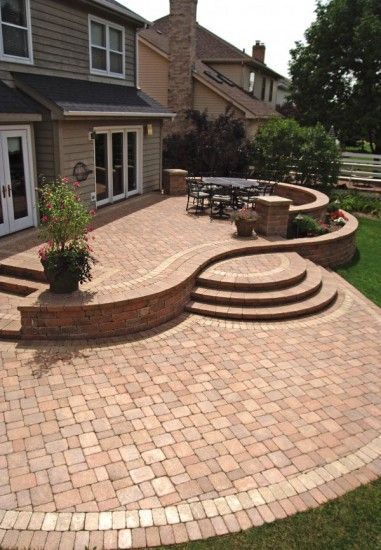 Patio wall step and pillar featuring Unilock Olde Quarry paver