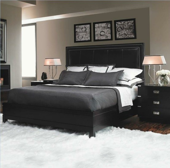 Many nice elements, black headboard, grey comforter, photos above the bed, black nightstand and nice lamps. No fluffy white rug though